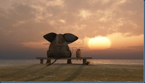 12648419-elephant-and-dog-sit-on-a-summer-beach[1]